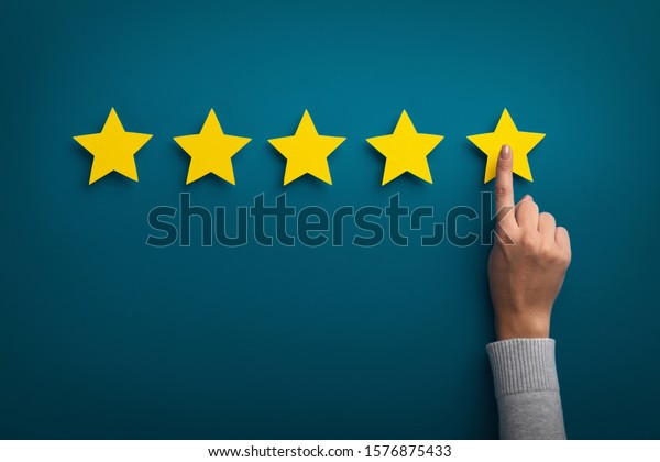Customer Experience Concept. Woman hand showing on five star excellent rating on background, copy space
