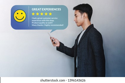 Customer Experience Concept. Young Businessman Reading a Positive Review via Smartphone. Online Satisfaction