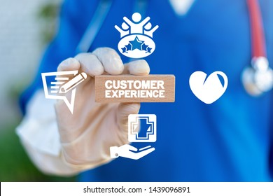 Customer experience healthcare concept. Patient satisfaction health. Medical client feedback. Doctor holds wooden cube with customer experience words.