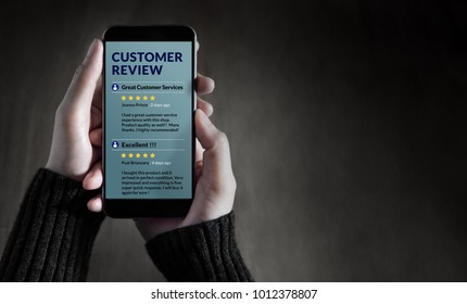 Customer Experience and Online Review Concept. Female holding SmartPhone to Reading Customer Review before Buying Products