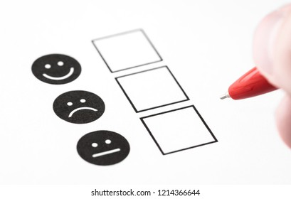 Customer experience survey, employee feedback questionnaire or business poll concept. Happy smile, neutral and sad frown faces on paper. Multiple choice research form with check box in psychology.
