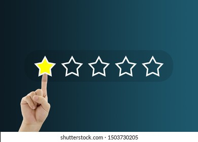 Customer Feedback Concept : Hand pressing one yellow star for giving best service ranking.