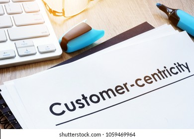 Customer in focus concept. Papers about Customer-centricity.