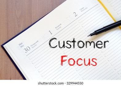 Customer focus text concept write on notebook