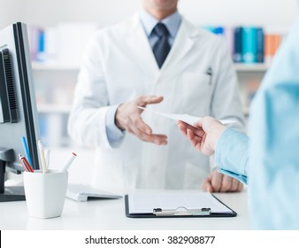 Customer giving a medical prescription to the pharmacist, treatment and healthcare concept