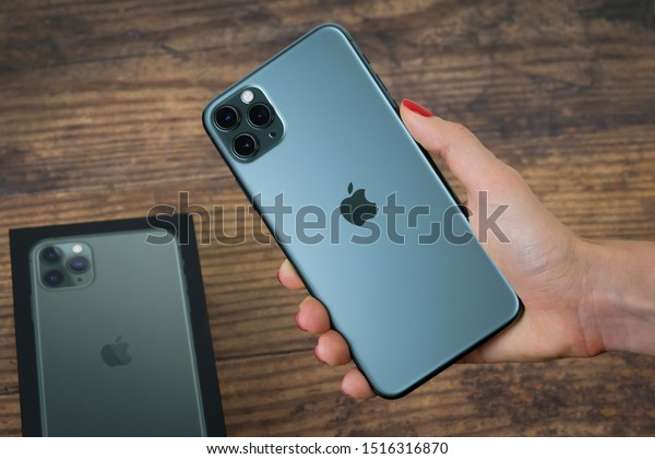 Customer holding the iPhone 11 Max Pro (midnight green) in their hand after phone was purchased on launch day. Manhattan, New York, USA September 20, 2019.