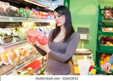 Customer looking at a product in a grocery store