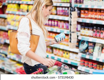 Customer looking at a product at the supermarket