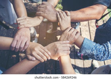 Customer Loyalty Team. Trustworthy diversity business Team positive motivated with hands together. Trust helping unified communications with loyalty customers and other. Communication Concept.
