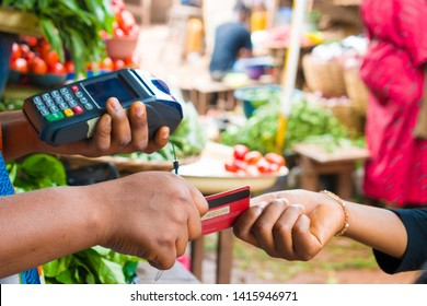 customer making payment with smart card reader