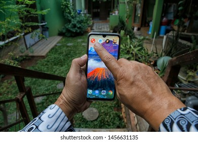 A customer is opening a Shutterstock application in Bekasi, West Java, Indonesia, on July 20, 2019.