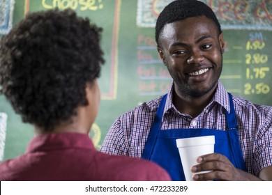 Customer ordering coffee in a coffee shop