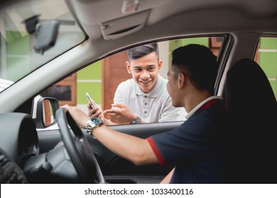 customer ordering taxi via online apps from his mobile phone
