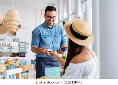 Customer paying his bills using credit card