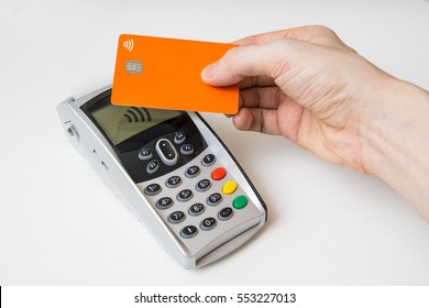 Customer is paying using contactless credit card and payment terminal.