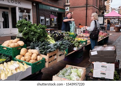 Customer purchasing fruit and vegetables from a street stand set up in centre of pedestrian street in Lwes, East, Sussex, September 13, 2019