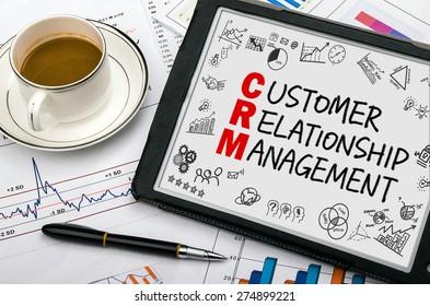 customer relationship management concept handwritten on tablet pc