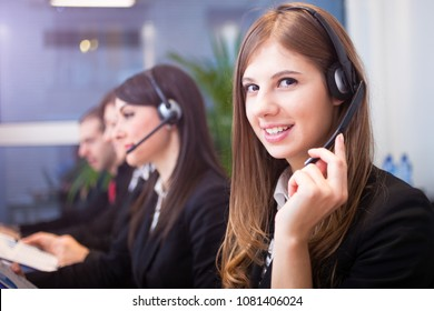 Customer representative using headset in her office
