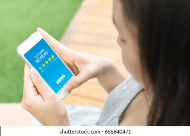 Customer review rating business concept, Woman hand using mobile phone