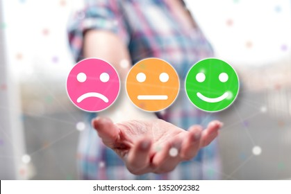 Customer satisfaction concept above the hand of a woman in background