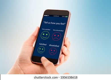 Customer Satisfaction survey concept.Hands holding mobile phone on blurred abstract background
