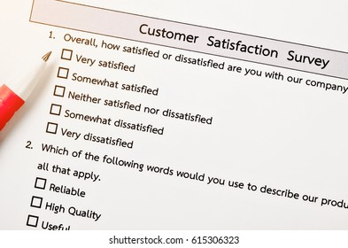 Customer satisfactory survey form with red pen.