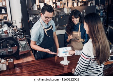 customer self service order drink menu with tablet screen and pay bill online at cafe counter bar,seller coffee shop accept payment by mobile.digital lifestyle concept