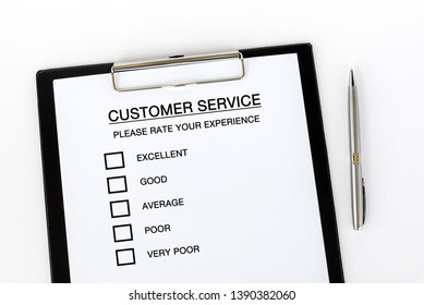 Customer Service Checklist on attached on Clip board and pen on white background