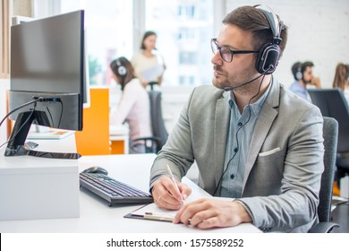 Customer service executive doing some paperwork at office