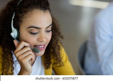Customer service executive talking on headset in office