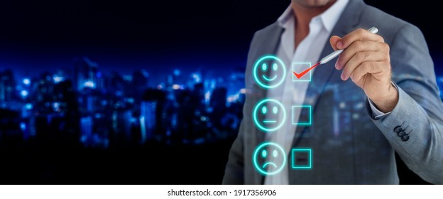 Customer service experience,quality control, ISO standards and business satisfaction survey concept.Businessman holding pen and choose to rating score happy icons.