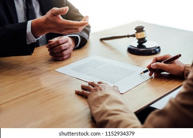 Customer service good cooperation, Consultation between a Businesswoman and Male lawyer or judge consult having team meeting with client, Law and Legal services concept.