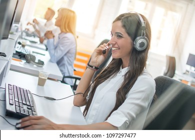 Customer service operator woman with headset working on computer at office