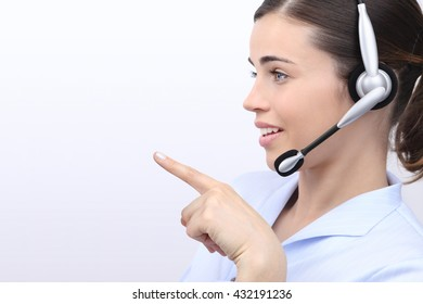 customer service operator woman with headset pointing her finger isolated on white background