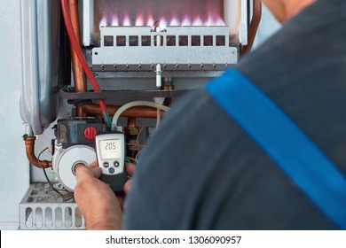 Customer service for the repair and adjustment of the gas boiler. The master checks the gas pressure gauge