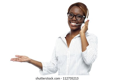 Customer service representative attending calls. Making gestures with hand while explaining it to client