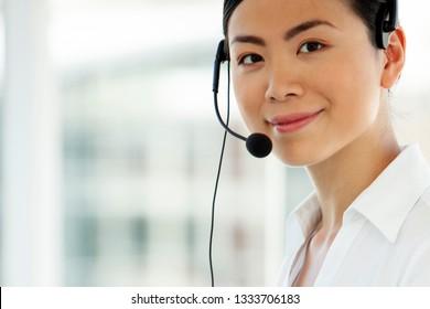 customer service representative - portrait of asian call center operator