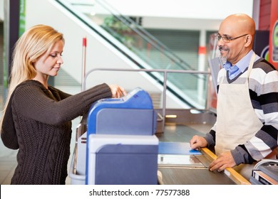 Customer and shop assistant at supermarket