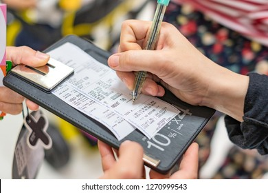 Customer signing on credit card slip shopping mall