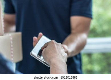Customer is signing on phone when couriers are sending from ordinary mail services by features such as speed, security, tracking, signature, specialization and individualization of express services.