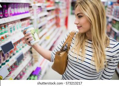 Customer at supermarket looking at a product