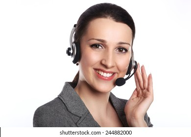 Customer support operator. Woman face.Call center smiling operator with phone headset on white background.Attractive young people working in a call center