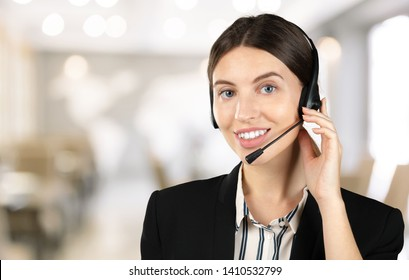 customer support phone operator in headset, with blank copyspace area for slogan or text message