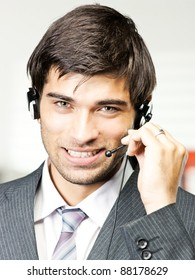 customer support phone operator in headset at office
