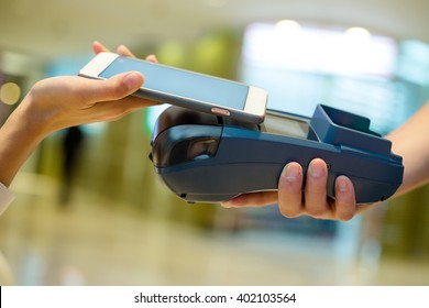 Customer using cellphone for payment