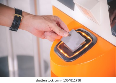 Customer using credit cart for payment to owner at cafe restaurant, cashless technology and credit card payment concept, Wireless technology is going much further