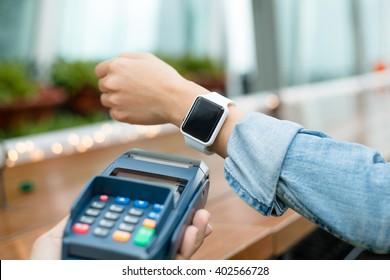 Customer using smart watch to pay