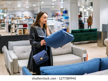 Customer woman buying new furniture - sofa or couch in a store supermarket mall store