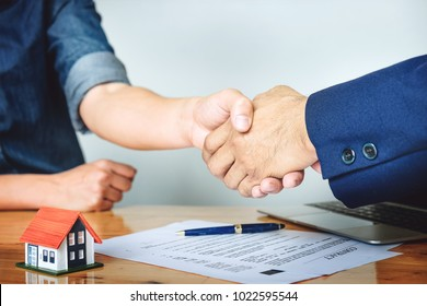 Customers agree to buy a house with a real estate agent. Signing contract. Agreement concept.