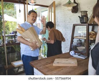 Customers bought bread waving goodbye